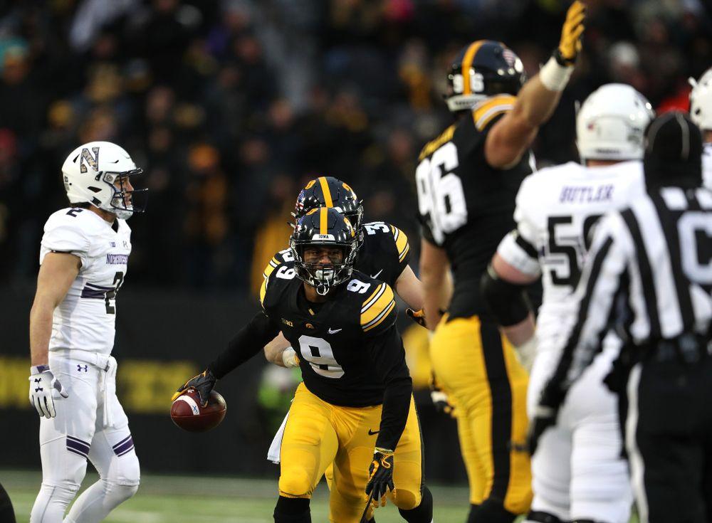 Iowa Hawkeyes defensive back Geno Stone (9) intercepts a pass against the Northwestern Wildcats Saturday, November 10, 2018 at Kinnick Stadium. (Brian Ray/hawkeyesports.com)