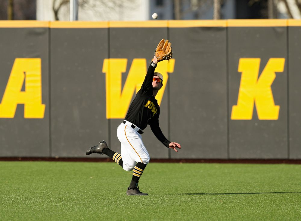 Iowa outfielder Justin Jenkins (6) makes a running catch for an out during the fourth inning of their college baseball game at Duane Banks Field in Iowa City on Tuesday, March 10, 2020. (Stephen Mally/hawkeyesports.com)