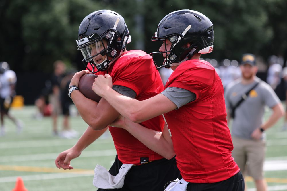 Iowa Hawkeyes quarterback Nathan Stanley (4) and quarterback Spencer Petras (7) during practice No. 4 of Fall Camp Monday, August 6, 2018 at the Hansen Football Performance Center. (Brian Ray/hawkeyesports.com)