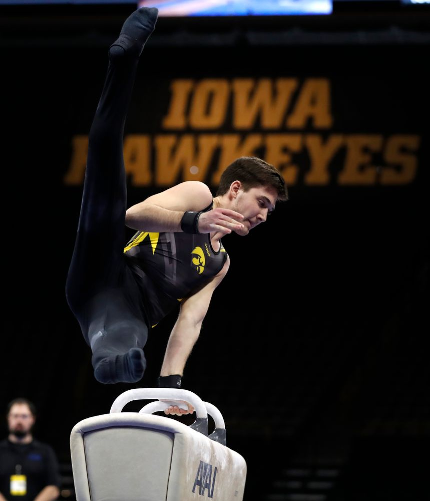 Kevin Johnson competes on the pommel horse against Illinois