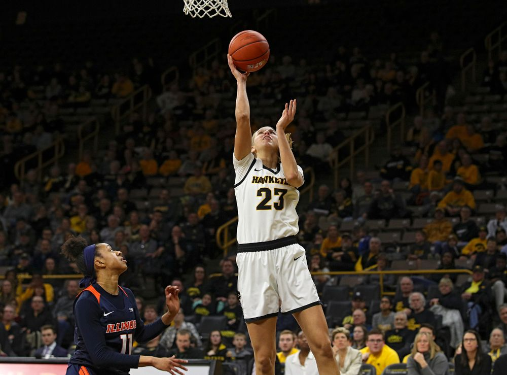 Iowa Hawkeyes forward Logan Cook (23) scores a basket during the fourth quarter of their game at Carver-Hawkeye Arena in Iowa City on Tuesday, December 31, 2019. (Stephen Mally/hawkeyesports.com)