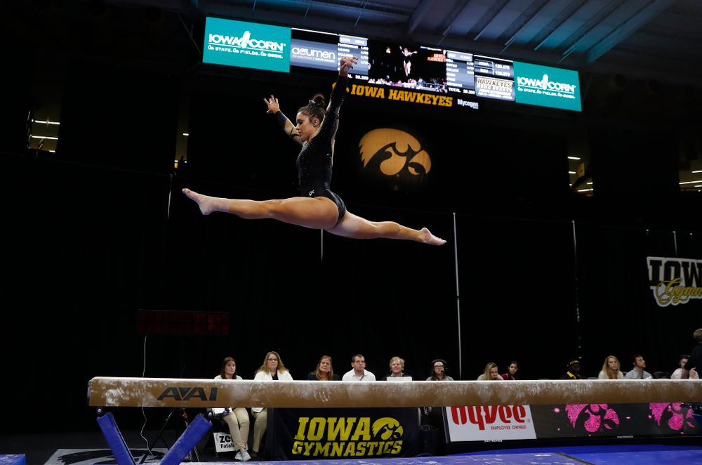 Iowa's Nikki Youd competes on the beam