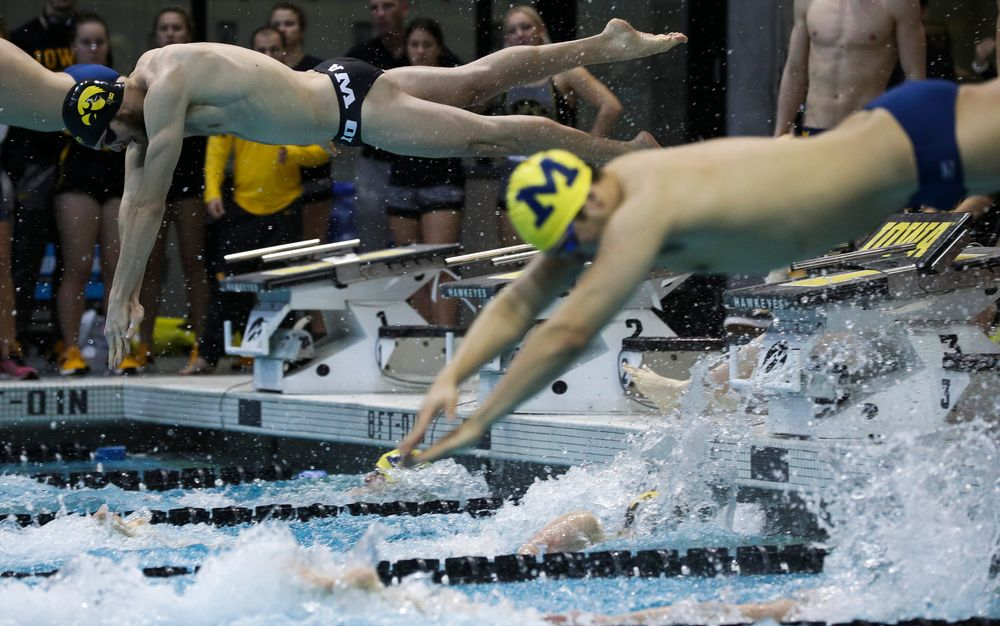 Iowa's Jack Smith competes in the 200-yard freestyle relay during a meet against Michigan and Denver at the Campus Recreation and Wellness Center on November 3, 2018. (Tork Mason/hawkeyesports.com)