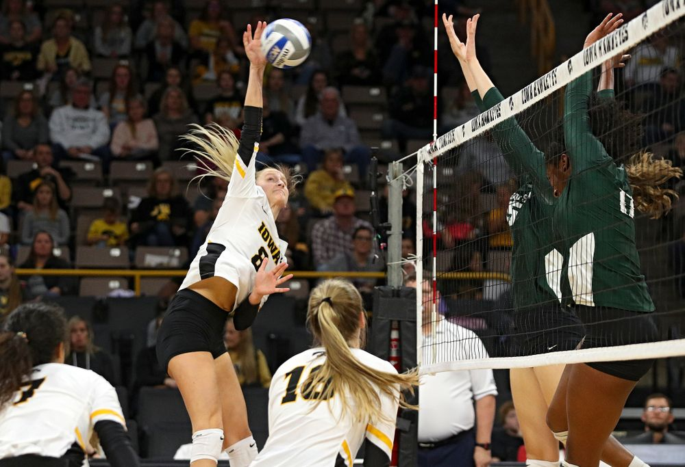 Iowa's Kyndra Hansen (8) lines up a shot during the second set of their volleyball match at Carver-Hawkeye Arena in Iowa City on Sunday, Oct 13, 2019. (Stephen Mally/hawkeyesports.com)