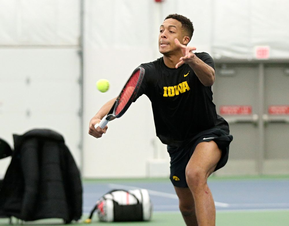 Iowa's Oliver Okonkwo returns a shot during his doubles match at the Hawkeye Tennis and Recreation Complex in Iowa City on Friday, February 14, 2020. (Stephen Mally/hawkeyesports.com)