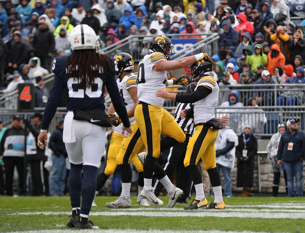 Iowa Hawkeyes defensive end Sam Brincks (90) celebrates with punter Colten Rastetter (7) catching a touchdown pass against the Penn State Nittany Lions Saturday, October 27, 2018 at Beaver Stadium in University Park, Pa. (Brian Ray/hawkeyesports.com)