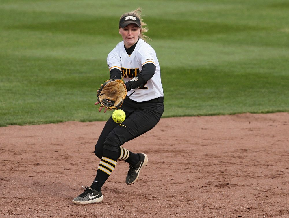 Iowa second baseman Aralee Bogar (2) fields a ground ball before stepping on second base for an out during the fourth inning of their game against Illinois at Pearl Field in Iowa City on Friday, Apr. 12, 2019. (Stephen Mally/hawkeyesports.com)