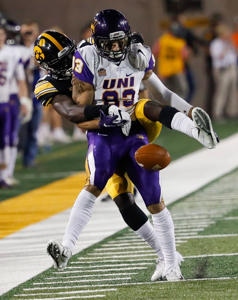 Iowa Hawkeyes defensive back Michael Ojemudia (11) breaks up a pass during a game against Northern Iowa at Kinnick Stadium on September 15, 2018. (Tork Mason/hawkeyesports.com)