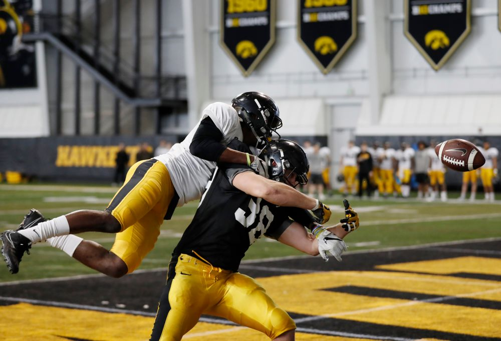 Iowa Hawkeyes defensive back Michael Ojemudia (11) and tight end T.J. Hockenson (38) Wednesday, April 4, 2018 at the Hansen Football Performance Center. (Brian Ray/hawkeyesports.com)