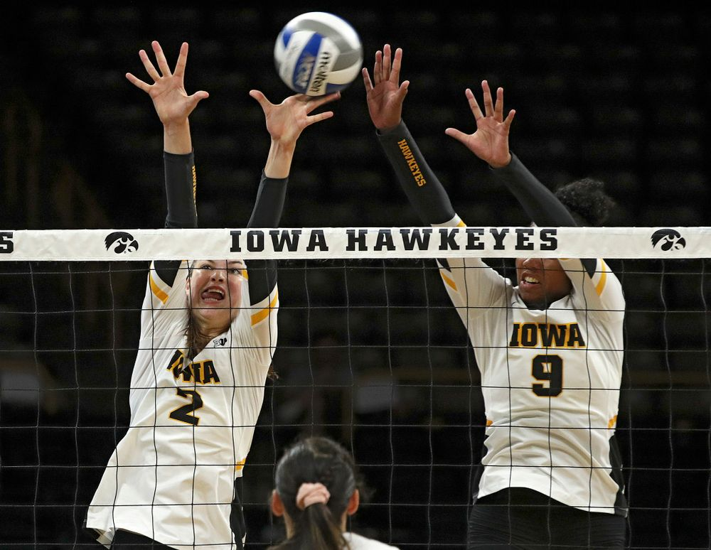 Iowa's Courtney Buzzerio (2) gets her hand on the ball as Amiya Jones (9) tries for the block during their Big Ten/Pac-12 Challenge match at Carver-Hawkeye Arena in Iowa City on Saturday, Sep 7, 2019. (Stephen Mally/hawkeyesports.com)