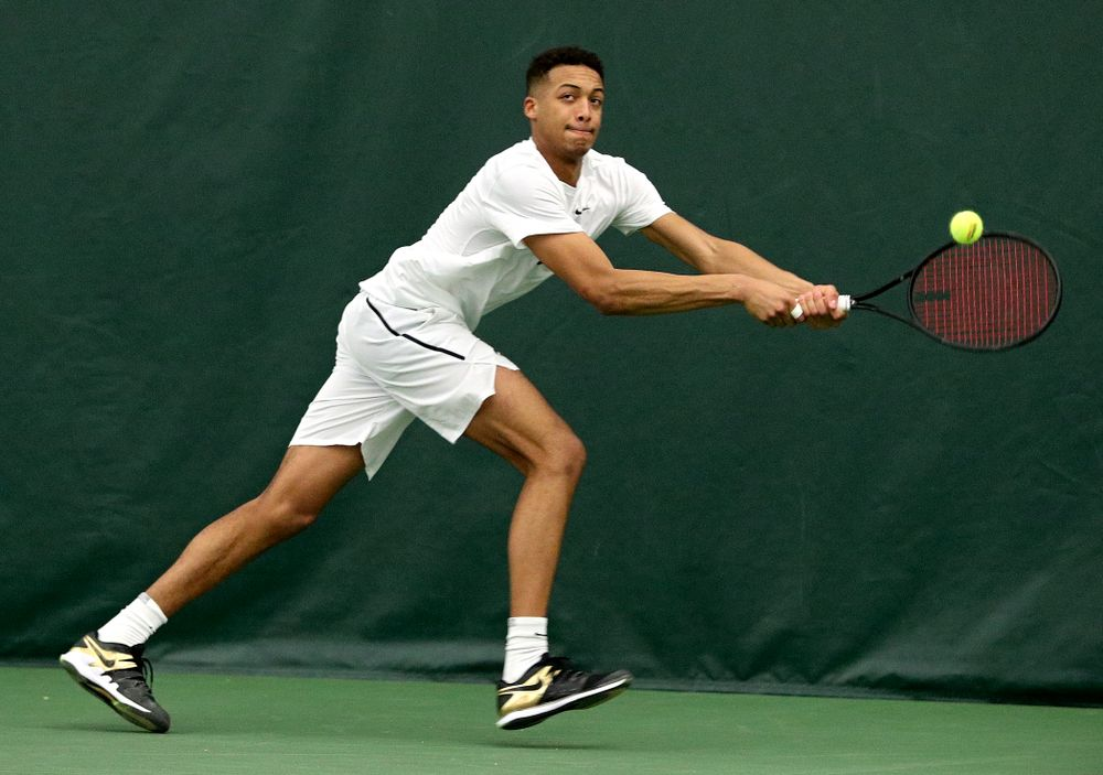 Iowa's Oliver Okonkwo returns a shot during his singles match at the Hawkeye Tennis and Recreation Complex in Iowa City on Sunday, February 16, 2020. (Stephen Mally/hawkeyesports.com)