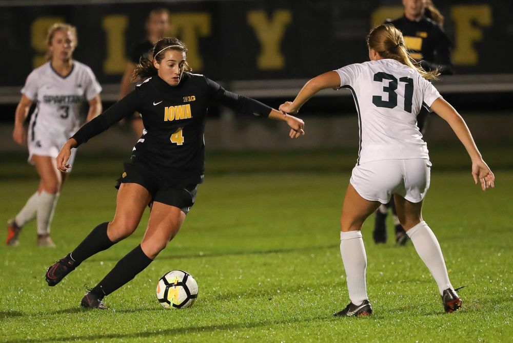 Iowa Hawkeyes forward Kaleigh Haus (4) dribbles the ball during a game against Michigan State at the Iowa Soccer Complex on October 12, 2018. (Tork Mason/hawkeyesports.com)