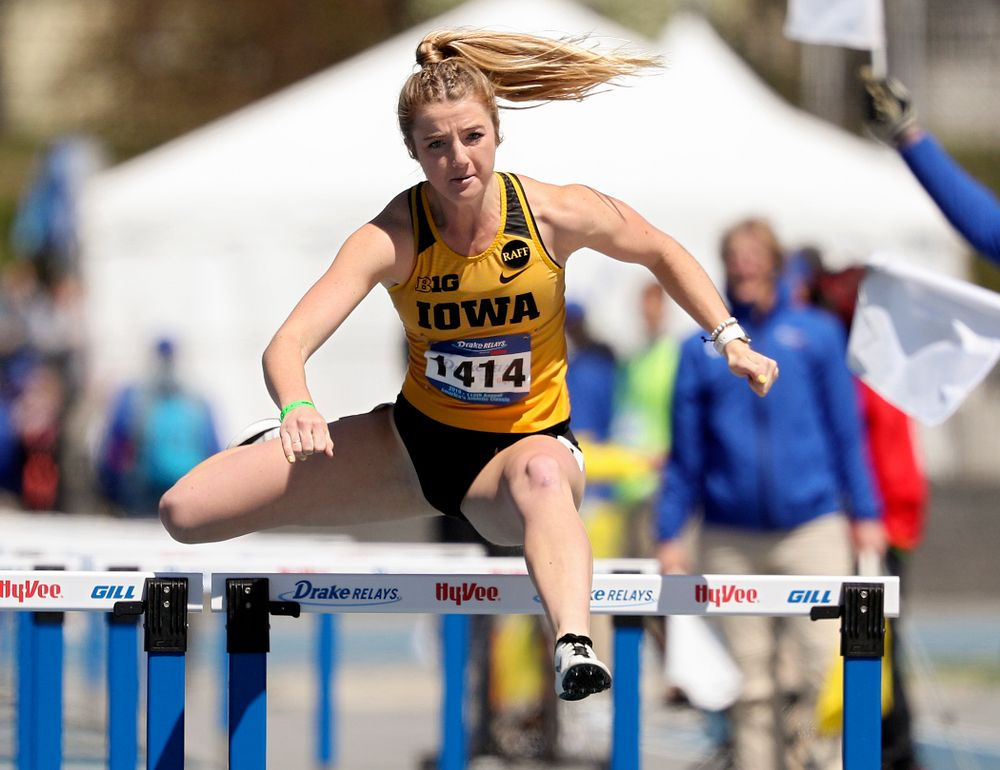 Iowa's Sydney Winger runs the women's 100 meter hurdles event during the second day of the Drake Relays at Drake Stadium in Des Moines on Friday, Apr. 26, 2019. (Stephen Mally/hawkeyesports.com)