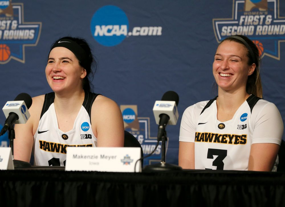 Iowa Hawkeyes forward Megan Gustafson (10) and guard Makenzie Meyer (3) share a laugh as they talk during their press availability after winning their game in the first round of the 2019 NCAA Women's Basketball Tournament at Carver Hawkeye Arena in Iowa City on Friday, Mar. 22, 2019. (Stephen Mally for hawkeyesports.com)