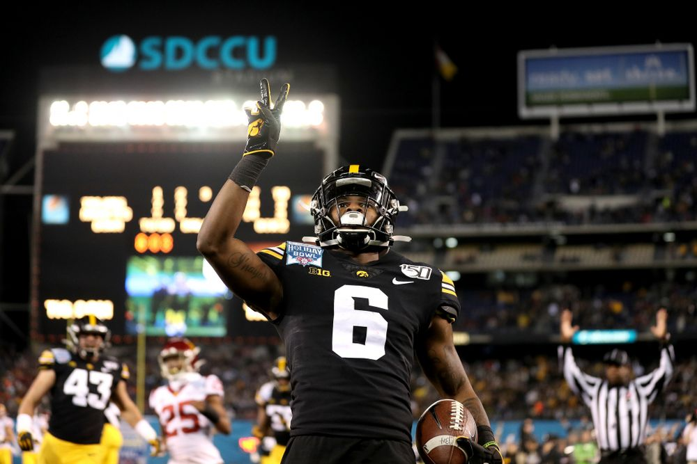 Iowa Hawkeyes wide receiver Ihmir Smith-Marsette (6) celebrates after scoring on a kick return against USC in the Holiday Bowl Friday, December 27, 2019 at San Diego Community Credit Union Stadium.  (Brian Ray/hawkeyesports.com)