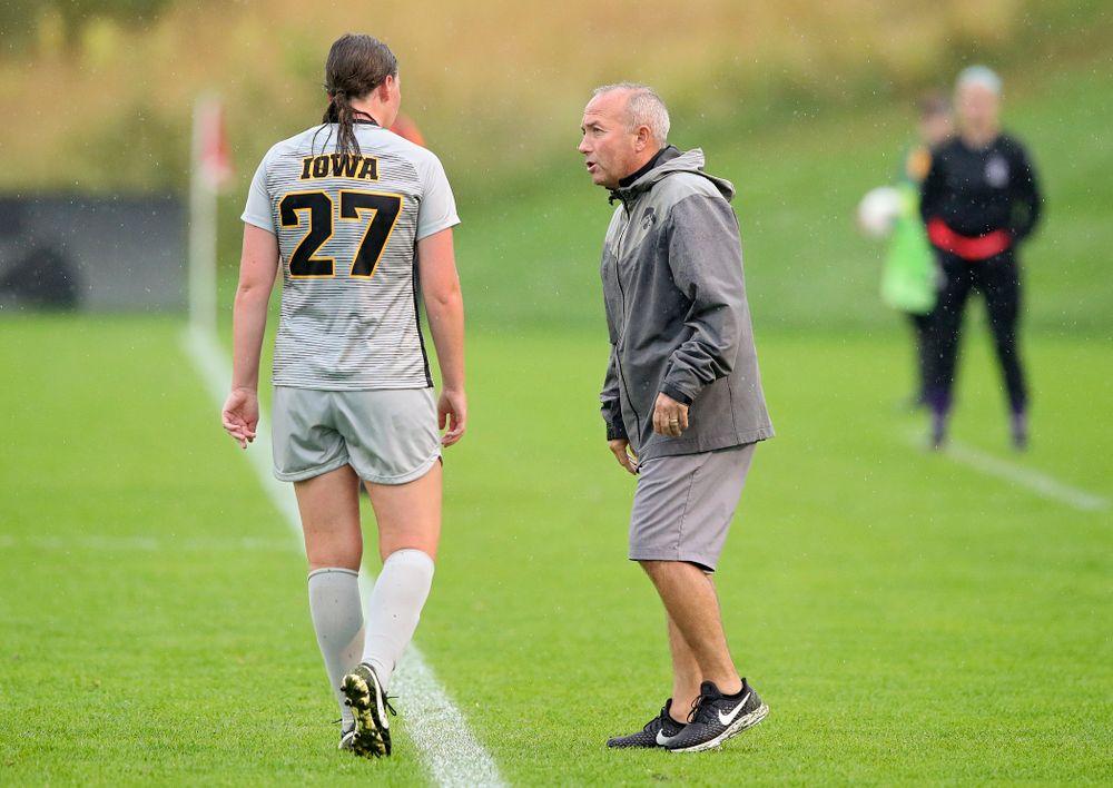 Iowa forward Samantha Tawharu (27) talks with head coach Dave DiIanni during the second half of their match at the Iowa Soccer Complex in Iowa City on Sunday, Sep 29, 2019. (Stephen Mally/hawkeyesports.com)