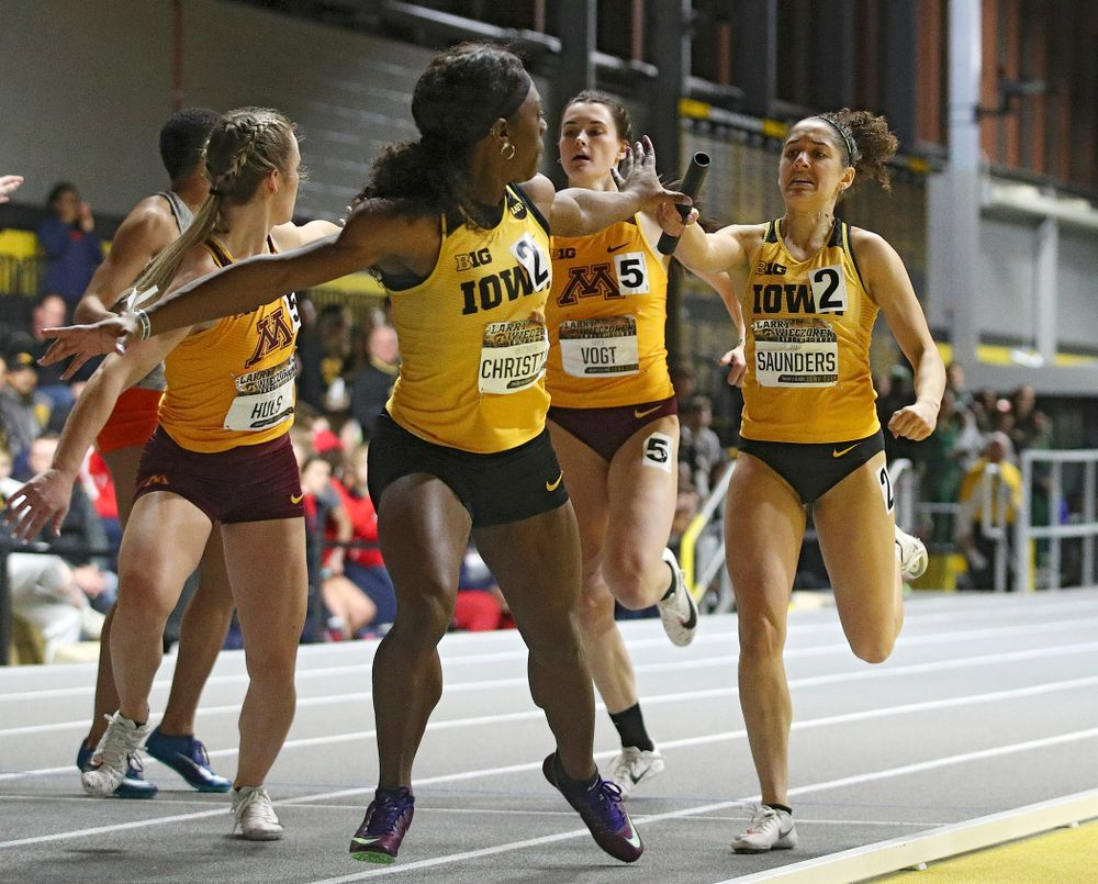 Iowa's Antonise Christian (from left) takes the baton from Tia Saunders runs the women's 1600 meter relay premier event during the Larry Wieczorek Invitational at the Recreation Building in Iowa City on Saturday, January 18, 2020. (Stephen Mally/hawkeyesports.com)