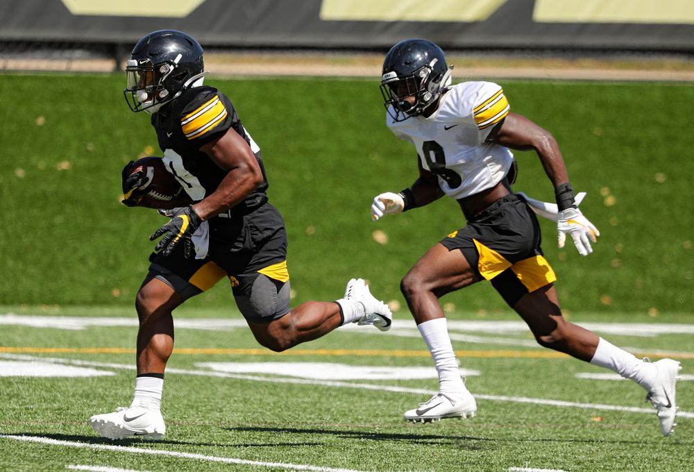 Iowa Hawkeyes running back Mekhi Sargent (10) runs down field as defensive back Matt Hankins (8) gives chase during Fall Camp Practice No. 7 at the Hansen Football Performance Center in Iowa City on Friday, Aug 9, 2019. (Stephen Mally/hawkeyesports.com)