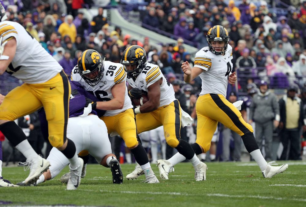 Iowa Hawkeyes running back Mekhi Sargent (10) gets a block from fullback Brady Ross (36) on his way to a touchdown against the Northwestern Wildcats Saturday, October 26, 2019 at Ryan Field in Evanston, Ill. (Brian Ray/hawkeyesports.com)