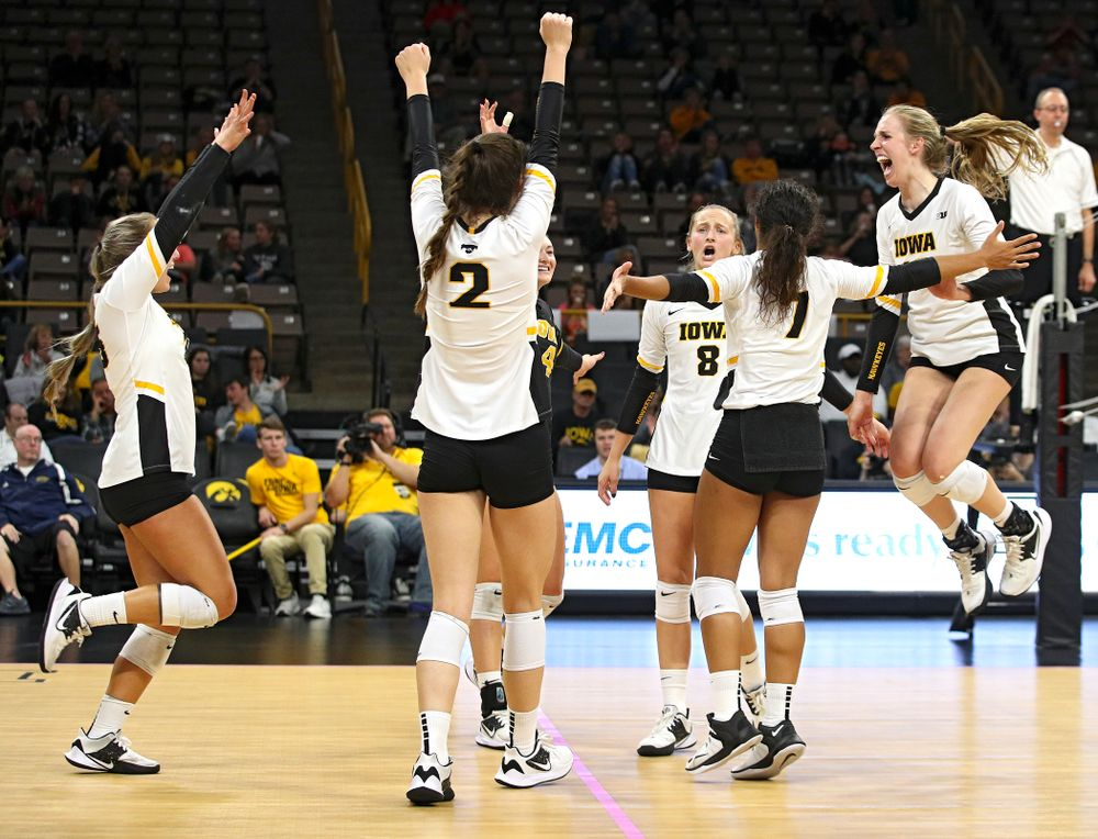 Iowa's Maddie Slagle (15), Courtney Buzzerio (2), Halle Johnston (4), Kyndra Hansen (8), Brie Orr (7), and Hannah Clayton (18) celebrate a score during the third set of their volleyball match at Carver-Hawkeye Arena in Iowa City on Sunday, Oct 13, 2019. (Stephen Mally/hawkeyesports.com)