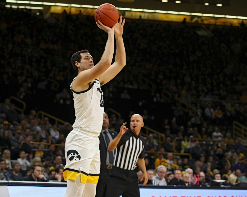 Iowa Hawkeyes forward Ryan Kriener (15) makes a 3-pointer during the first half of their their game at Carver-Hawkeye Arena in Iowa City on Sunday, December 29, 2019. (Stephen Mally/hawkeyesports.com)