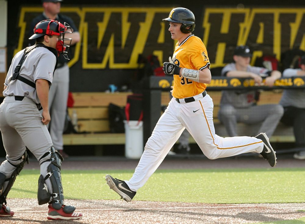Iowa Hawkeyes catcher Brett McCleary (32) scores a run during the fourth inning of their game against Northern Illinois at Duane Banks Field in Iowa City on Tuesday, Apr. 16, 2019. (Stephen Mally/hawkeyesports.com)