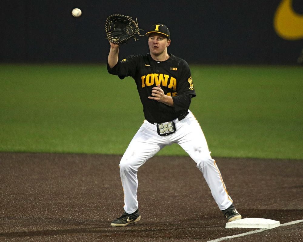 Iowa first baseman Peyton Williams (45) looks in a throw during the seventh inning of their game at Duane Banks Field in Iowa City on Tuesday, March 3, 2020. (Stephen Mally/hawkeyesports.com)