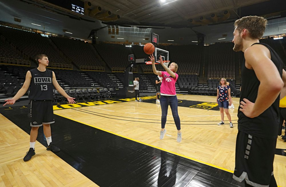 Iowa Hawkeyes guard Austin Ash (13) and forward Riley Till (20) shoot free throws with visitors from the University of Iowa Hospitals and Clinics Adolescent and Young Adult (AYA) Cancer Program after practice at Carver-Hawkeye Arena in Iowa City on Monday, Sep 30, 2019. (Stephen Mally/hawkeyesports.com)