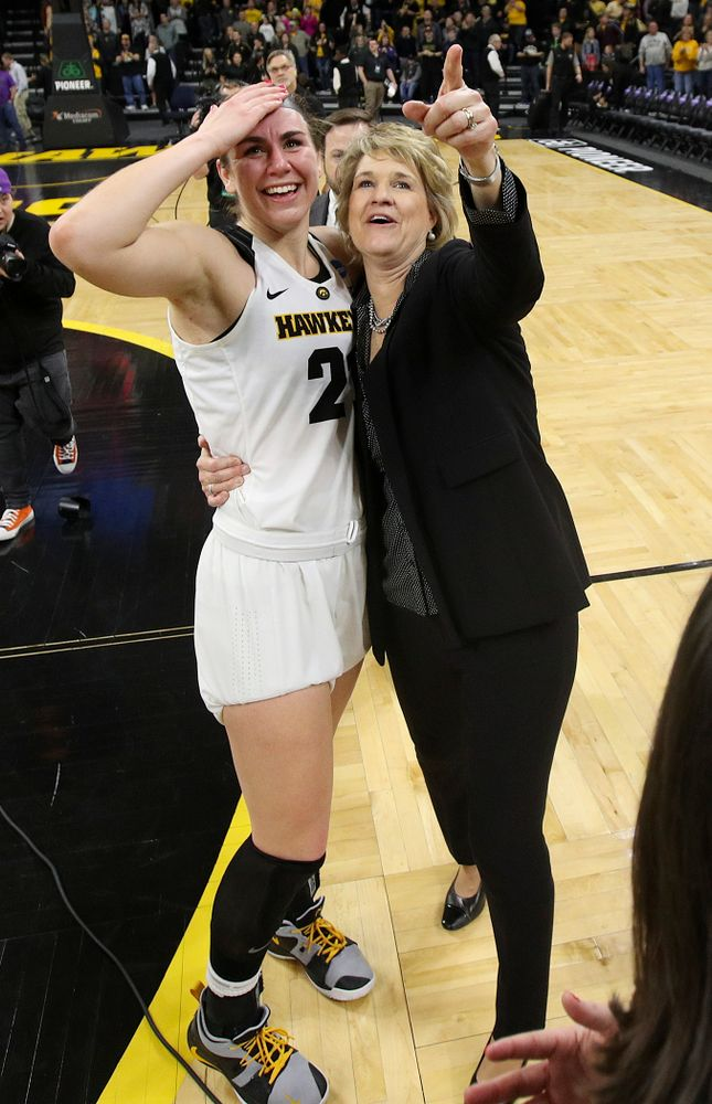Iowa Hawkeyes forward Hannah Stewart (21) and head coach Lisa Bluder look up at the video board after winning their second round game in the 2019 NCAA Women's Basketball Tournament at Carver Hawkeye Arena in Iowa City on Sunday, Mar. 24, 2019. (Stephen Mally for hawkeyesports.com)