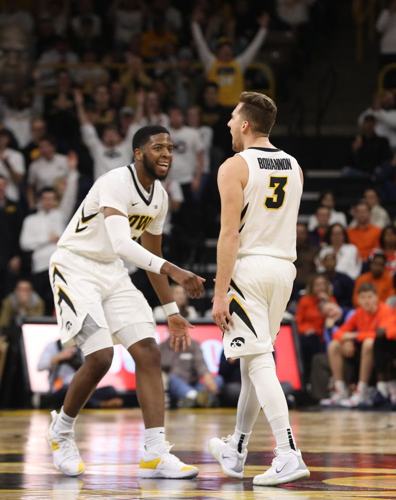 Iowa Hawkeyes guard Isaiah Moss (4) and guard Jordan Bohannon (3) celebrate after a three point basket against the Illinois Fighting Illini Sunday, January 20, 2019 at Carver-Hawkeye Arena. (Brian Ray/hawkeyesports.com)