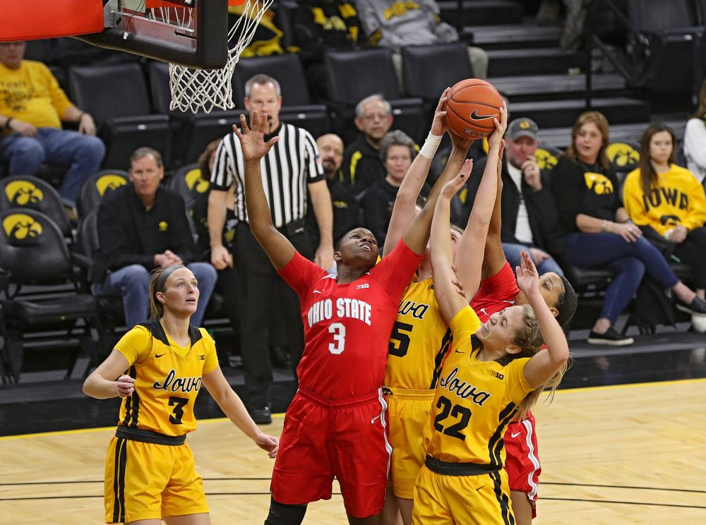 Iowa Hawkeyes forward Monika Czinano (25) and guard Kathleen Doyle (22) battle for a rebound during the second quarter of their game at Carver-Hawkeye Arena in Iowa City on Thursday, January 23, 2020. (Stephen Mally/hawkeyesports.com)