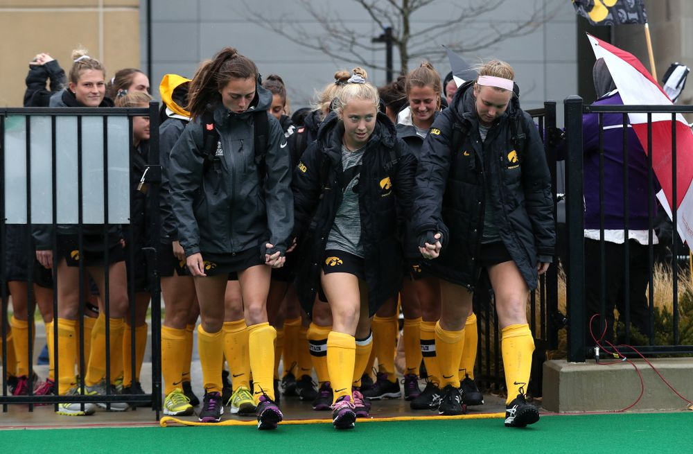 The Iowa Hawkeyes seniors cross the line before their game against Maryland in the championship game of the Big Ten Tournament Sunday, November 4, 2018 at Lakeside Field in Evanston, Ill. (Brian Ray/hawkeyesports.com)