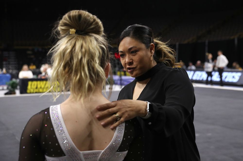 Iowa head coach Larissa Libby talks with Charlotte Sullivan before her routine on the floor during their meet against the Rutgers Scarlet Knights Saturday, January 26, 2019 at Carver-Hawkeye Arena. (Brian Ray/hawkeyesports.com)