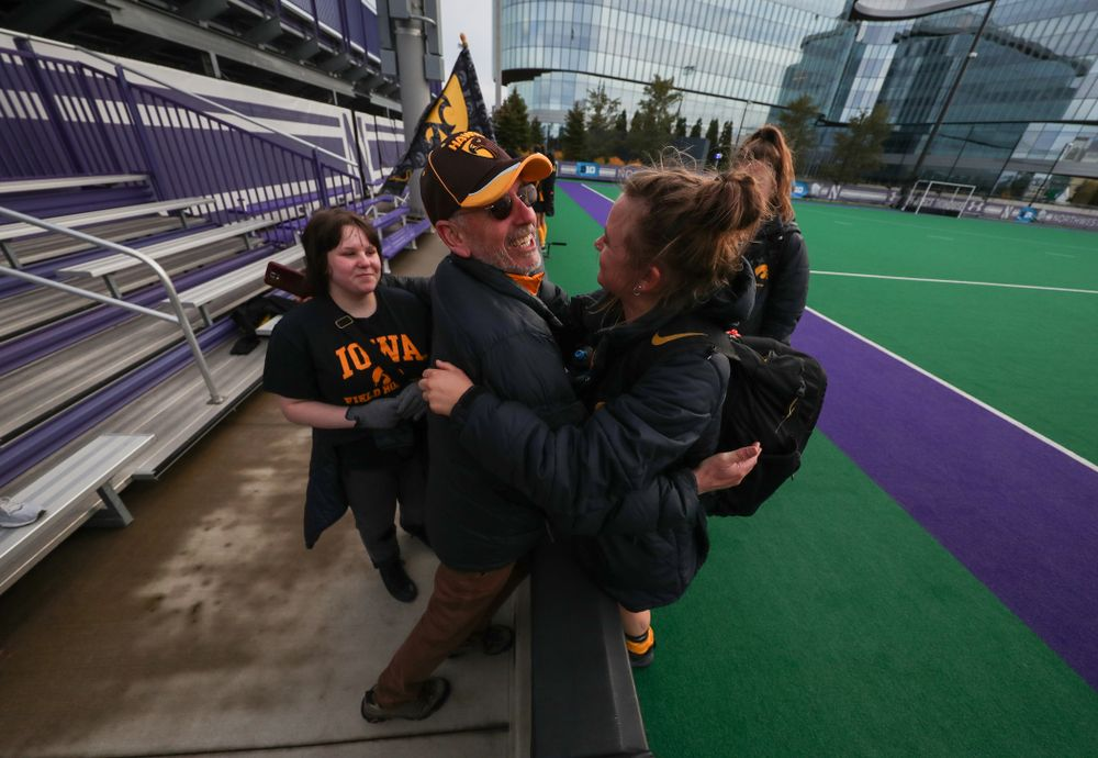 Iowa Hawkeyes Maddy Murphy (26) hugs her family after their 2-1 victory over the Michigan Wolverines in the semi-finals of the Big Ten Tournament Friday, November 2, 2018 at Lakeside Field on the campus of Northwestern University in Evanston, Ill. (Brian Ray/hawkeyesports.com)