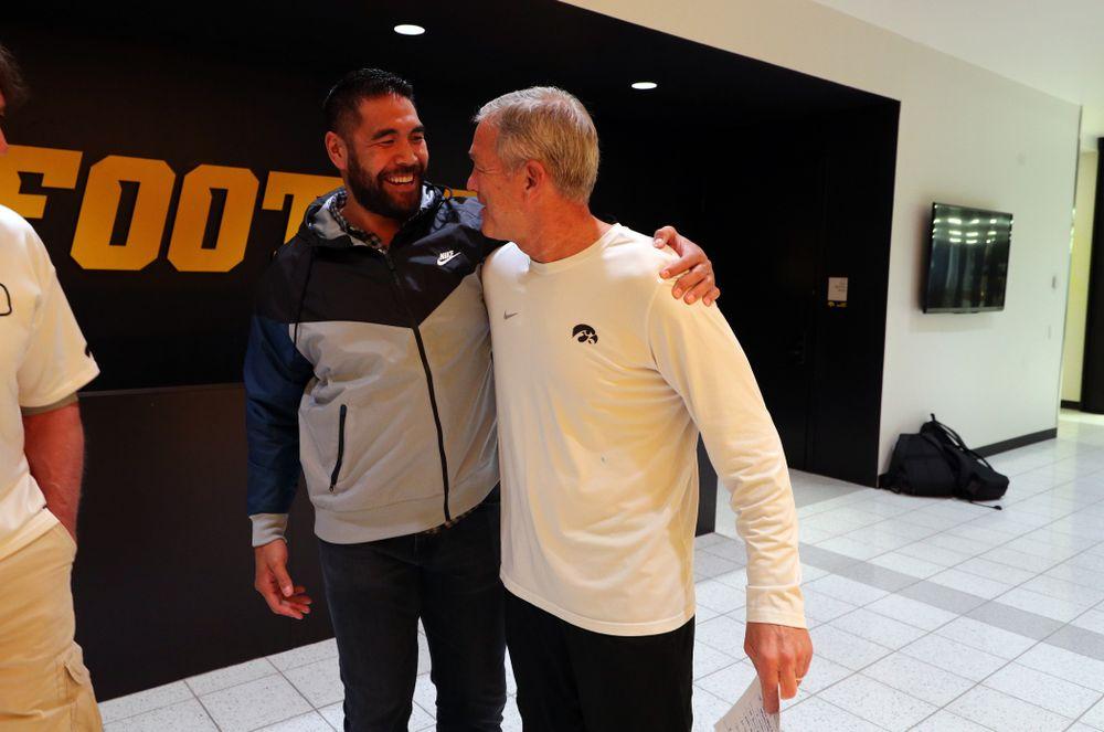 Iowa Hawkeyes head coach Kirk Ferentz talks with former tight end Tony Moeaki Friday, October 11, 2019 at the Hansen Football Performance Center. (Brian Ray/hawkeyesports.com)