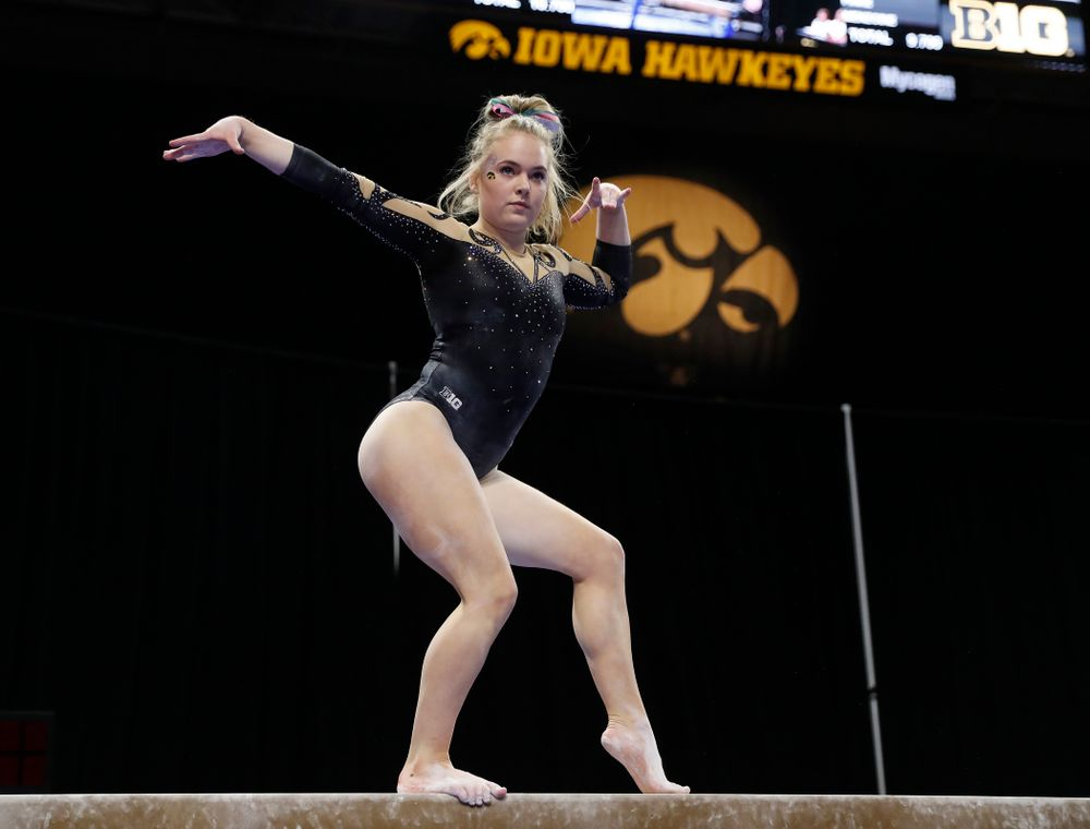Iowa's Charlotte Sullivan competes on the beam