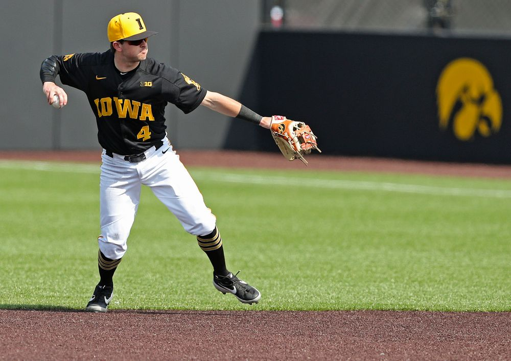 Iowa Hawkeyes second baseman Mitchell Boe (4) throws to first for an out during the fourth inning of their game against Rutgers at Duane Banks Field in Iowa City on Saturday, Apr. 6, 2019. (Stephen Mally/hawkeyesports.com)