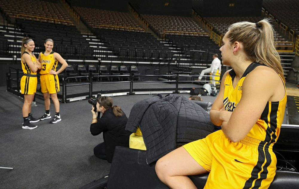 Iowa guard Kathleen Doyle (22) looks on as guard Megan Meyer (11) and guard Makenzie Meyer (3) pose for a picture during Iowa Women's Basketball Media Day at Carver-Hawkeye Arena in Iowa City on Thursday, Oct 24, 2019. (Stephen Mally/hawkeyesports.com)