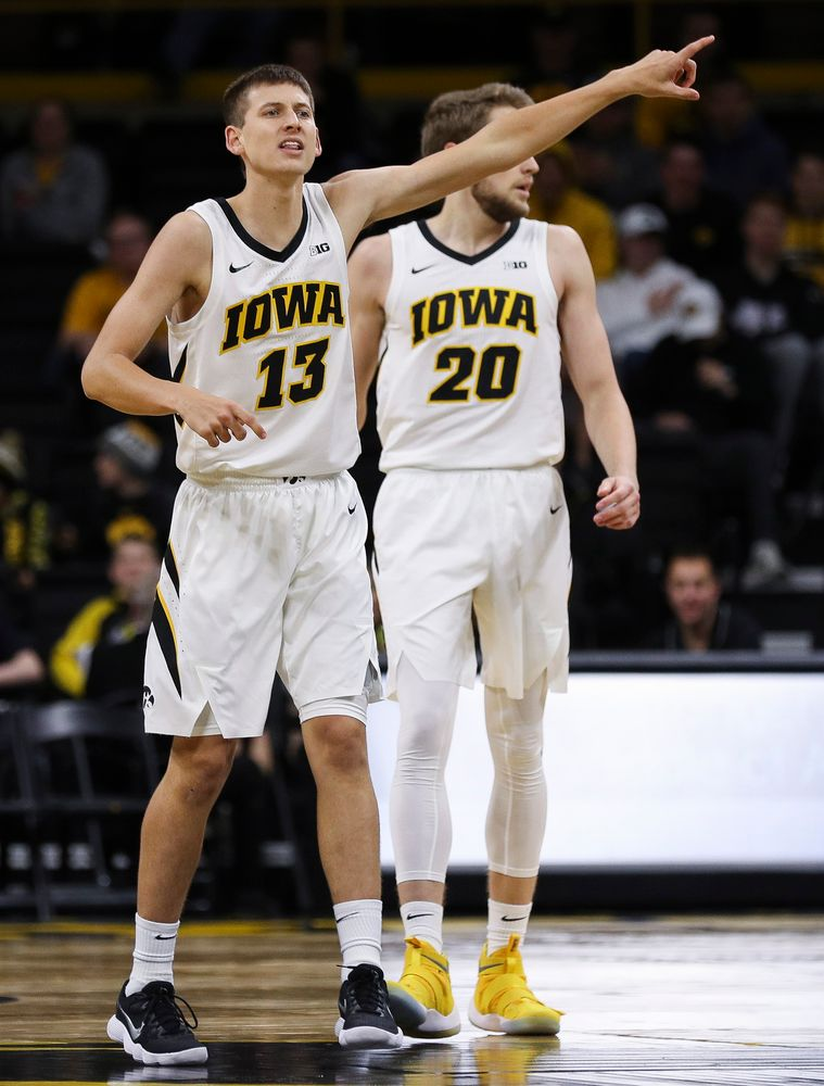 Iowa Hawkeyes guard Austin Ash (13) directs the defense in transition during a game against Guilford College at Carver-Hawkeye Arena on November 4, 2018. (Tork Mason/hawkeyesports.com)