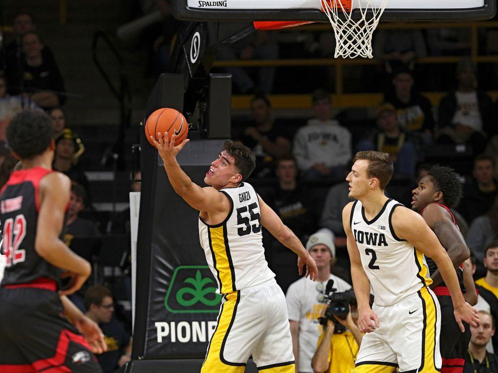 Iowa Hawkeyes center Luka Garza (55) pulls in a rebound during the second half of their game at Carver-Hawkeye Arena in Iowa City on Friday, Nov 8, 2019. (Stephen Mally/hawkeyesports.com)