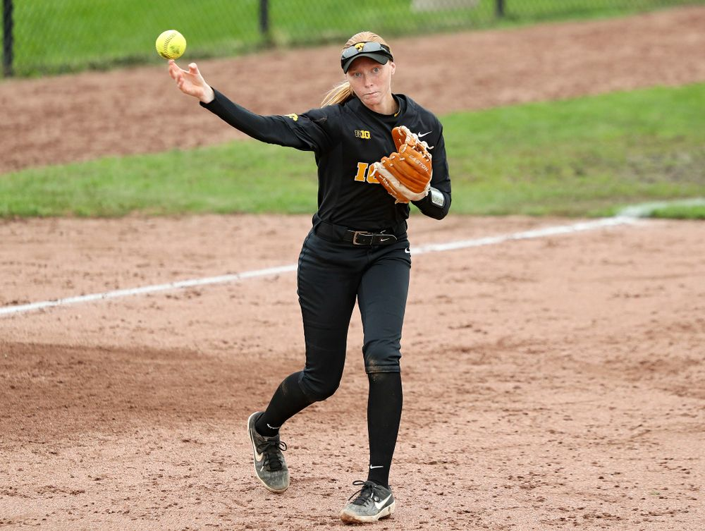 Iowa third baseman Ashley Hamilton (18) throws to first for an out during the sixth inning of their game against Iowa Softball vs Indian Hills Community College at Pearl Field in Iowa City on Sunday, Oct 6, 2019. (Stephen Mally/hawkeyesports.com)