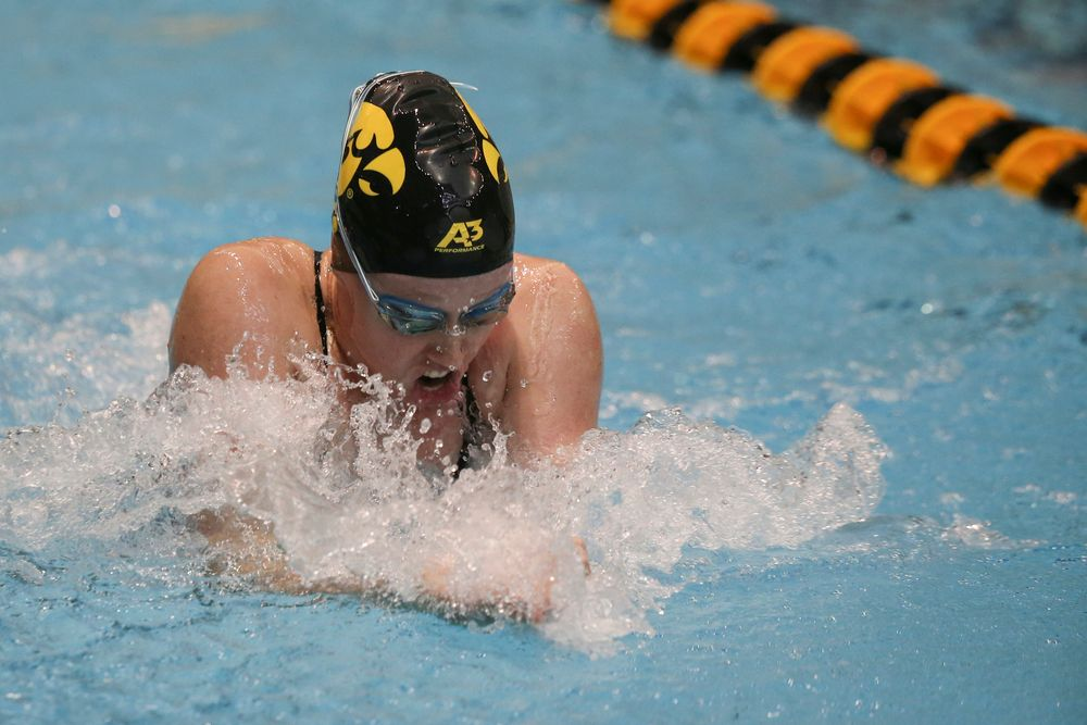 Iowa's Paige Hanley 100-yard breaststroke during the Iowa swimming and diving meet vs Notre Dame and Illinois on Saturday, January 11, 2020 at the Campus Recreation and Wellness Center. (Lily Smith/hawkeyesports.com)