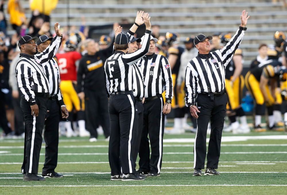 The officials wave to patients in the Stead Family Children's Hospital during Iowa Football's final spring practice Friday, April 20, 2018 at Kinnick Stadium. (Brian Ray/hawkeyesports.com)