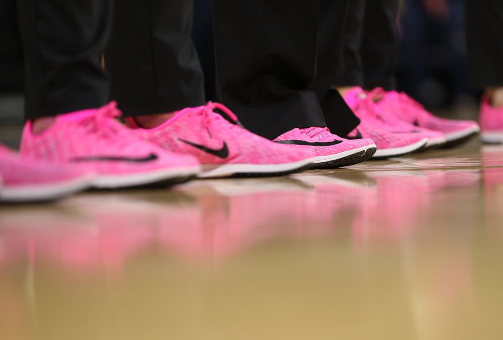 The Iowa Hawkeyes coaches and staff wear pink shoes against the Wisconsin Badgers Sunday, February 16, 2020 at Carver-Hawkeye Arena. (Brian Ray/hawkeyesports.com)