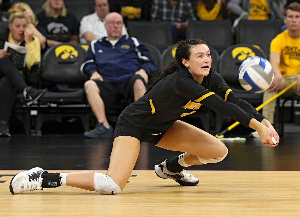 Iowa's Halle Johnston (4) gets a dig during the third set of their volleyball match at Carver-Hawkeye Arena in Iowa City on Sunday, Oct 13, 2019. (Stephen Mally/hawkeyesports.com)