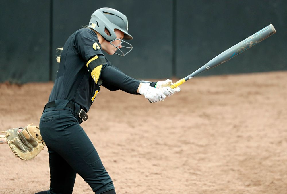 Iowa's Ashley Hamilton (18) hits an RBI single during the sixth inning of their game against Iowa Softball vs Indian Hills Community College at Pearl Field in Iowa City on Sunday, Oct 6, 2019. (Stephen Mally/hawkeyesports.com)