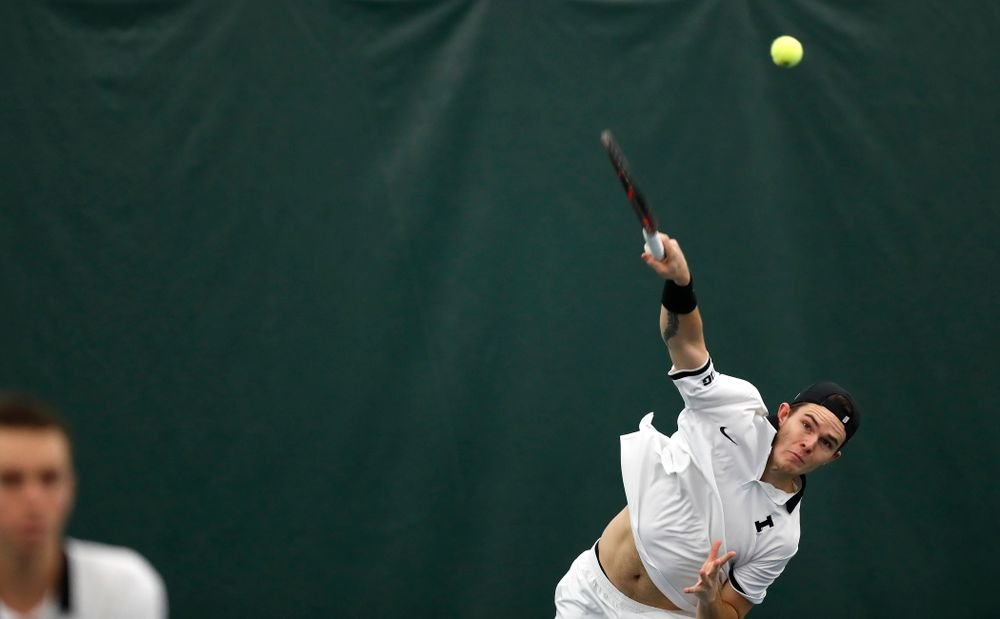 Jonas Larsen and Kareem Allaf play a doubles match against Purdue Sunday, April 15, 2018 at the Hawkeye Tennis and Recreation Center. (Brian Ray/hawkeyesports.com)