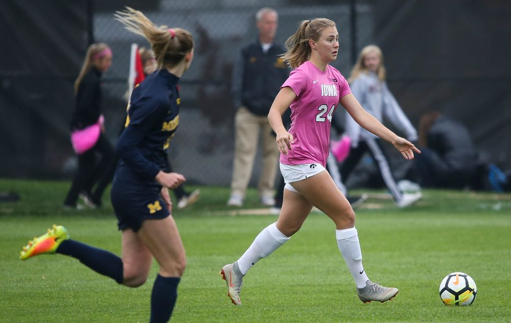 Iowa Hawkeyes defender Sara Wheaton (24) dribbles the ball during a game against Michigan at the Iowa Soccer Complex on October 14, 2018. (Tork Mason/hawkeyesports.com)
