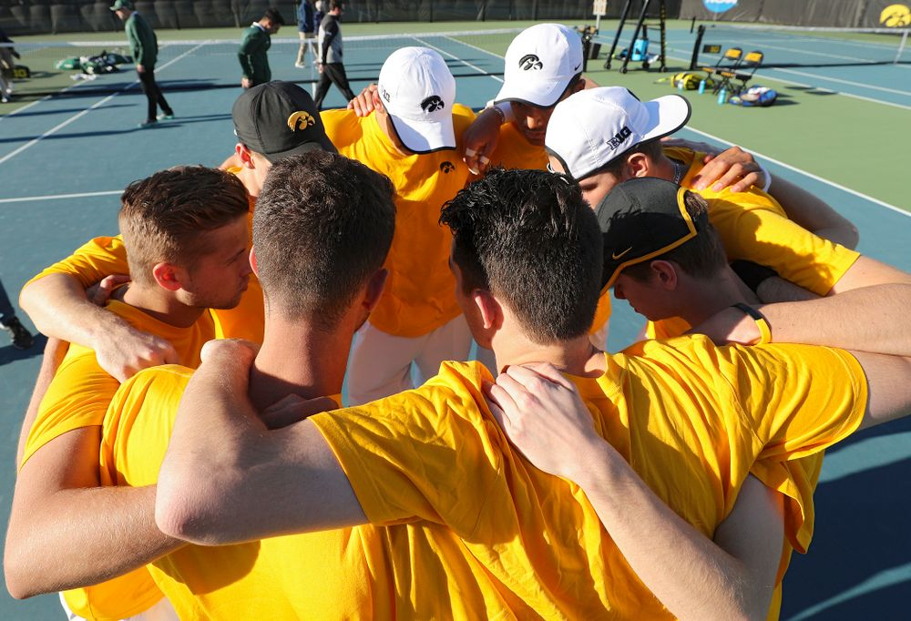 The Iowa Hawkeyes huddle before their match again Michigan State at the Hawkeye Tennis and Recreation Complex in Iowa City on Friday, Apr. 19, 2019. (Stephen Mally/hawkeyesports.com)