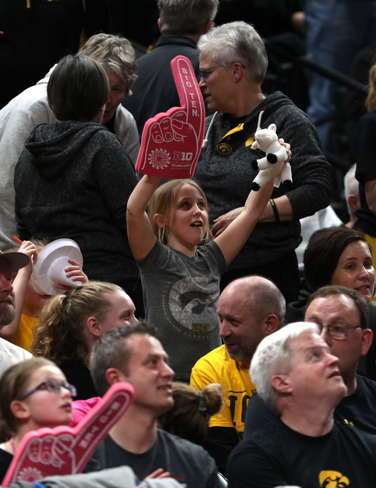 A little girl holds up a stuffed goat as the Iowa Hawkeyes take on the Rutgers Scarlet Knights in the semi-finals of the Big Ten Tournament Saturday, March 9, 2019 at Bankers Life Fieldhouse in Indianapolis, Ind. (Brian Ray/hawkeyesports.com)